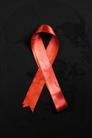 aids: Red ribbon HIV, AIDS isolated on black Stock Photo