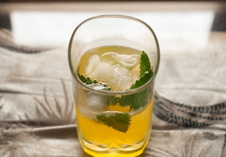 yellow to drink: yellow drink with ice and mint,cold cocktail closeup Stock Photo