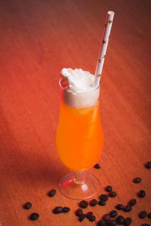 Pumpkin cocktail, straws with stars, drinks for a party on Halloween Stock Photo