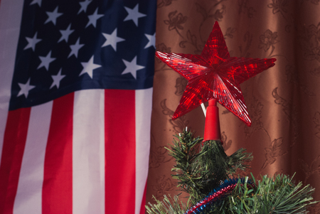 Detail beautiful Christmas tree on the background of the American flag, the trees top, the Christmas star