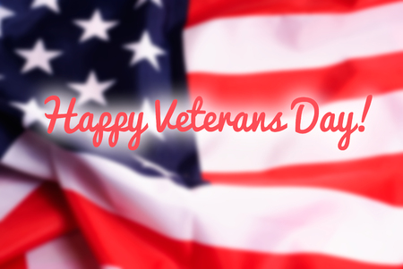 common blue: Happy Veterans Day sign on USA flag background Stock Photo