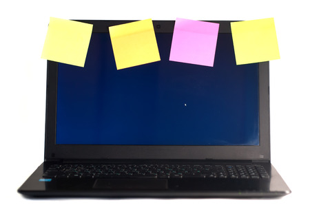 Laptop with reminders, isolated on white background, office, laptop plastered with colorful reminders