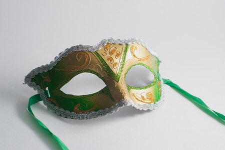 yellow and green Venetian mask on white background, concept of carnival, Gras Mardi Stock Photo