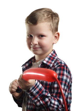 little boy inflates the balloon, isolated on white background, happy childhood, a young boy in a plaid shirt, baby closeup portrait