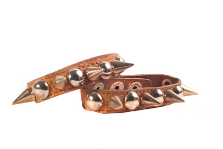 A brown leather bracelet with spikes isolated on white background, fashion accessory