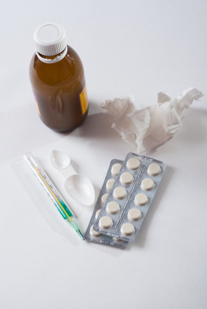 Set for flu treatment, thermometer, cough medicine, tablets, napkins, concept of protection against influenza Stock Photo