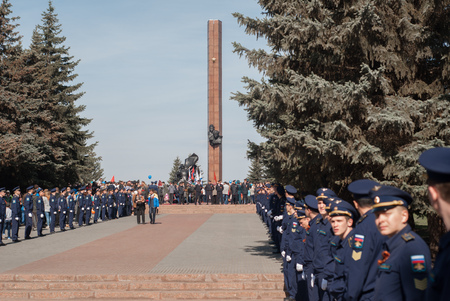a memorial to fallen soldiers: Ufa - Russia 9 may 2017 - Stella Victory Park, a memorial and honor of the fallen heroes of the great Patriotic war to Ufa, by a line of men in uniform