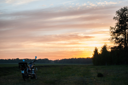 classic motorcycle on a sunset background, scenic landscape, travel by motorcycle
