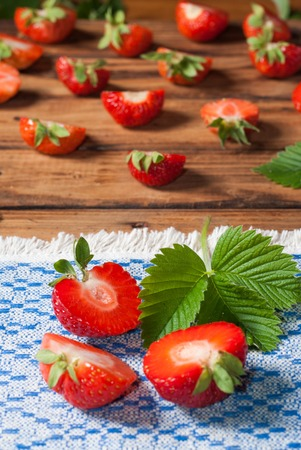 Strawberries closeup. an embroidered cloth.wooden background
