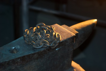 blacksmith: Rusty chain on the anvil, in the smithy