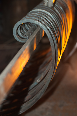 Forged parts, iron curls, the light from the fire horn