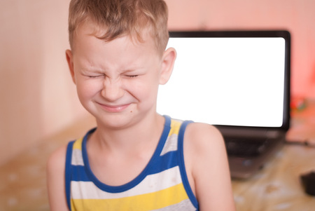 The boy in the background of malicious web pages with prohibited content, the child is horrified by what he saw on the Internet