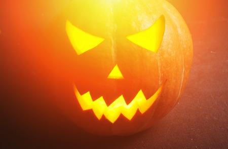 Jack-o  - lantern on a wooden table, happy Halloween Stock Photo