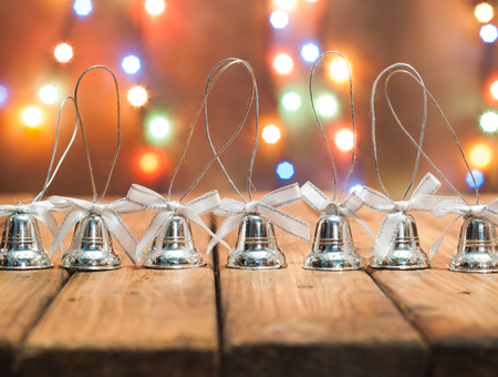 Christmas bells on bright bokeh background, festive background