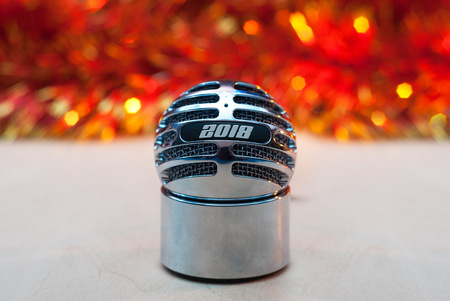Vintage condenser microphone, broadcasting into the new year, the inscription 2018, retro radio