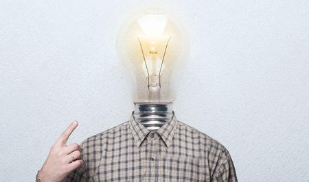 man is the light bulb. man in shirt with a light bulb instead of a head. the concept is a good idea
