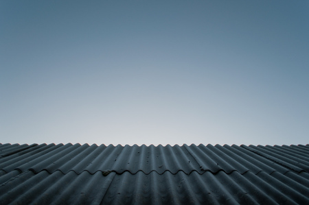 Texture of the old roof in the background , the roof of roofing material, corrugated surface Stock Photo