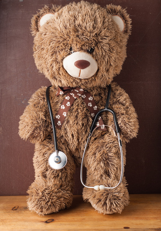 Teddy bear stands with a stethoscope, the concept of a pediatrician, toy