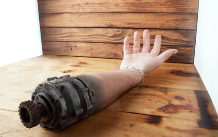 rusting replacement arm, shaft and gear wheel, mechanical human limb, concept future