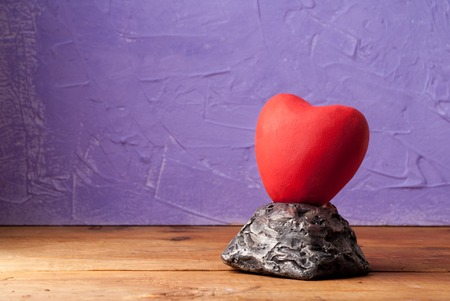 Red heart, concept of love and relationship, heart of stone
