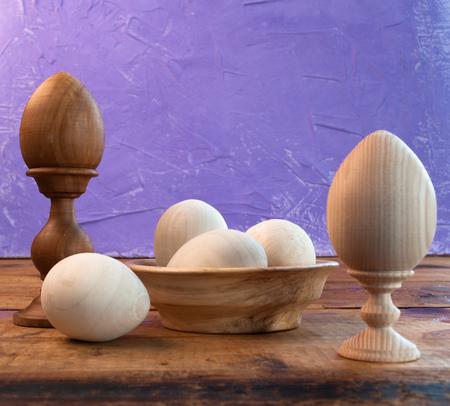 Easter composition, happy Easter concept, wooden eggs, purple background, Reklamní fotografie
