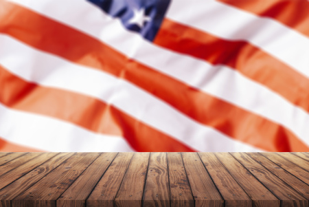 old wooden table for advertising goods on the background of the American flag, a template for the infographic of trade in the United States, a template for advertising goods from the United States