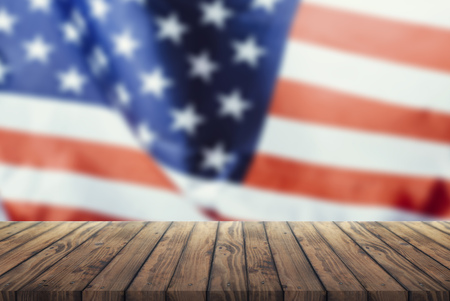 Us flag on a wooden old table. Concept of the 4th of July celebration