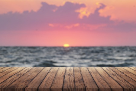 wooden retro deck and sunrise, summer vacation background, old wooden table for advertisement on sea sunset background, template for your advertisement