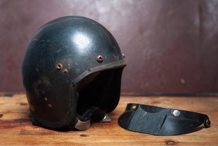 black vintage motorcycle helmet, classic helmet, old scratched helmet