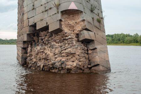 destruction of the bridge support. old bridge close-up, Stock Photo - 130800305