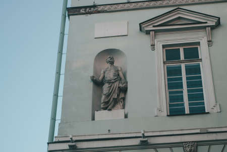 The facade of the building with ancient sculpture. Ancient Greek style in architecture,