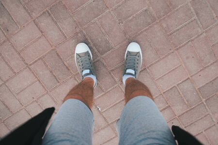 Young guy in sneakers and shorts, urban style,