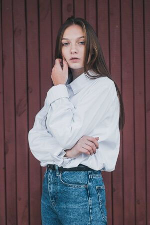 Young girl in blue jeans and white shirt,