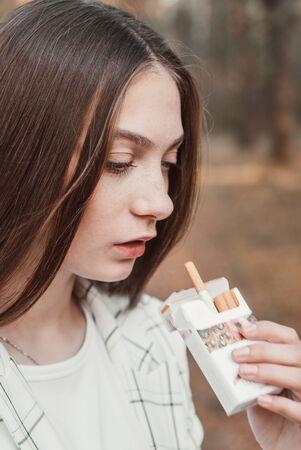 Closeup portrait of smoking beautiful young girl