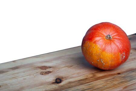 Pumpkin on the table. Fresh orange pumpkin isolated on white background,