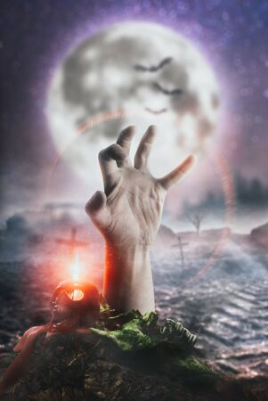 Scary zombie hand on moon background, risen from the dead Stok Fotoğraf