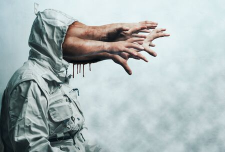 zombie hands stick out of the hood. terrible nightmare. Halloween background