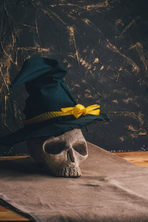 Skull of a sorcerer in a hat on a dark background