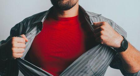 a bearded superhero tears his shirt Stok Fotoğraf