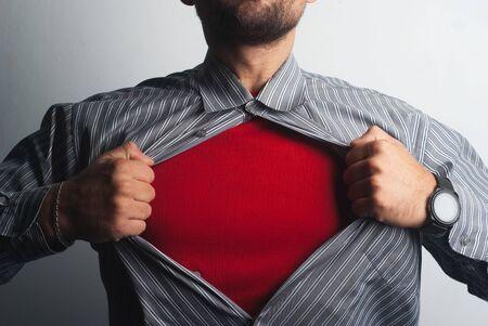 Superhero tears his shirt. red super suit under his clothes, Stok Fotoğraf