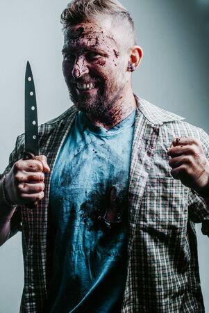 A bearded maniac with a knife. crazy grins of rotten teeth Stok Fotoğraf