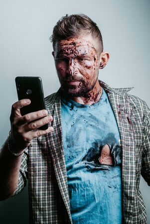 Halloween makeup selfie for social network. Zombies with the phone makes the photo