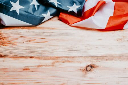 Closeup of American flag on wood background,