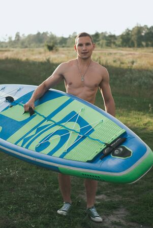 Paddle Board stand portrait. young surfer on outdoor, Stok Fotoğraf