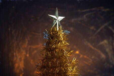 Yellow Christmas tree made of tinsel closeup