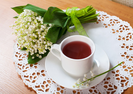 morning tea table setting with Lily of the valley flowers bouqete, gorisontal photo