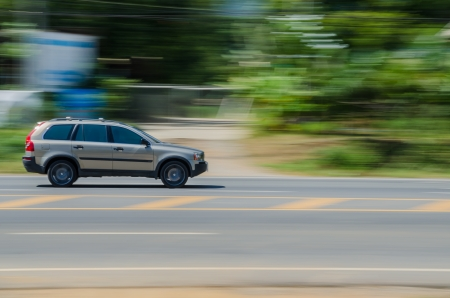 swerving: A car on the road at speed  Stock Photo