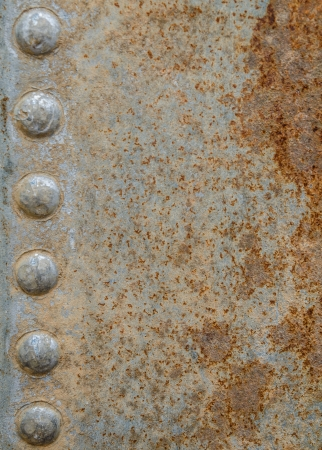 rusty metal plate with a seam and rivets