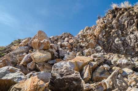 Rubble stone under blue sky photo