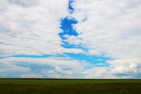 green meadow and cloudy sky Stock Photo